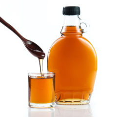 48852605 - maple syrup in glass bottle on white background