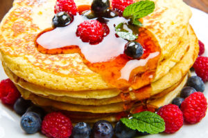 51100366 - pancakes with berries and maple syrup